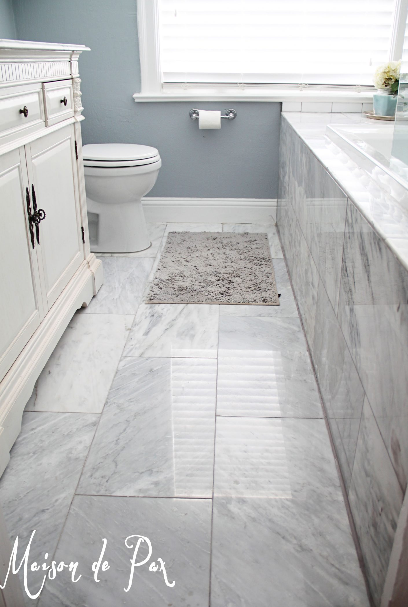 white floor tile bathroom bathroom renovations budget tips 21525
