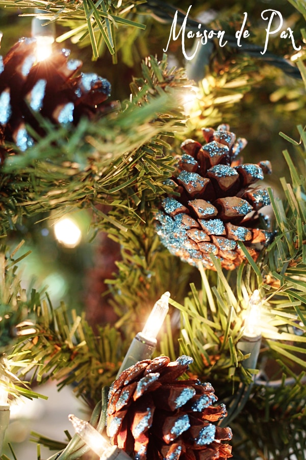 blue glitter pinecones on a Christmas tree- Maison de Pax