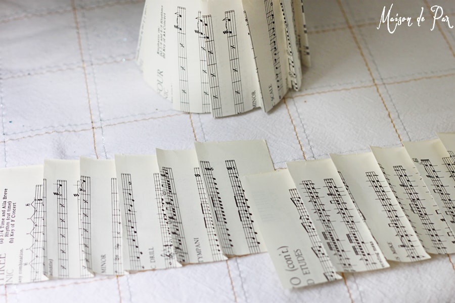folding sheet music to make christmas trees