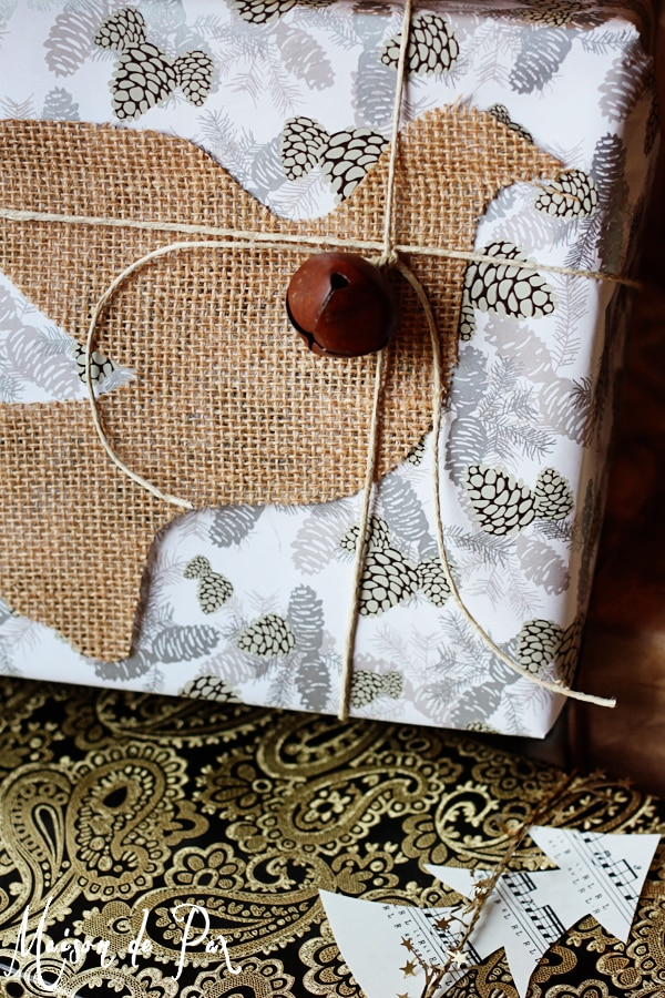 simple and stunning gift wrap ideas: burlap silhouette against metallic paper