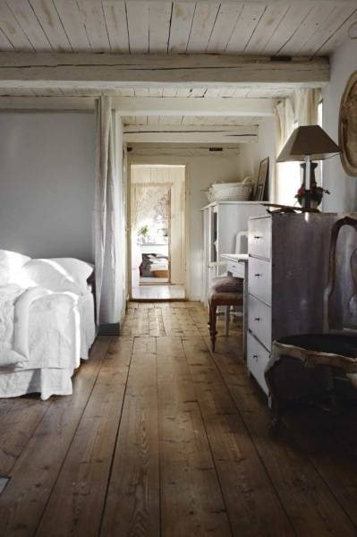 whitewashed planked ceiling with wide-planked brown floors