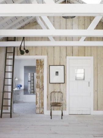 mixture of white painted and lightly whitewashed wooden planking