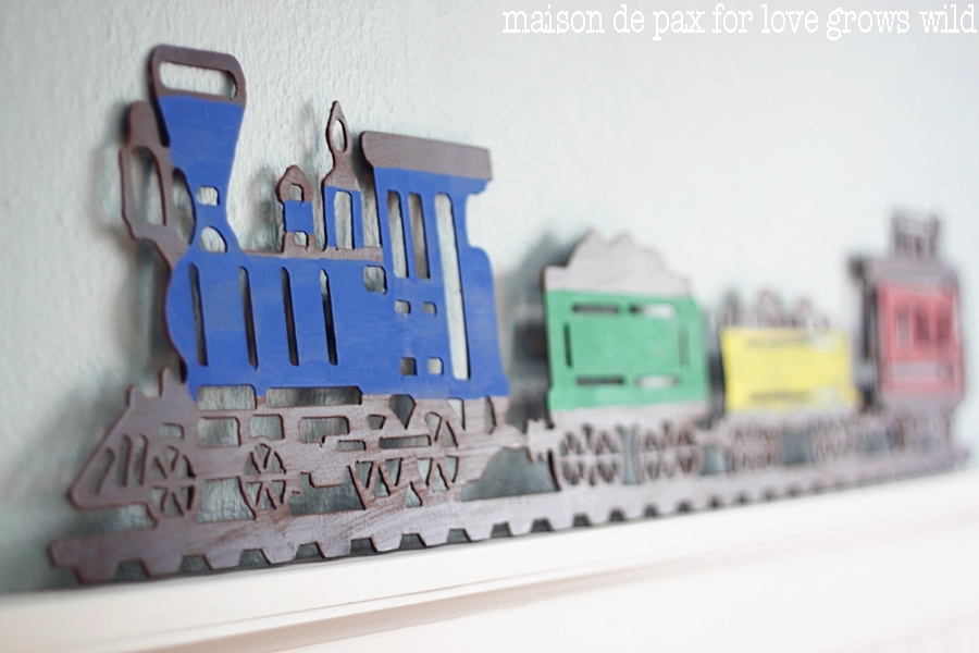 Add a little craft paint to an old metal sign and make an adorable statement piece!