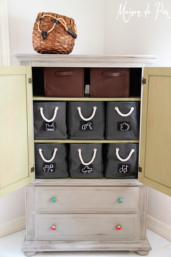 Chalkboard labeled storage boxes make playroom clean up a breeze!