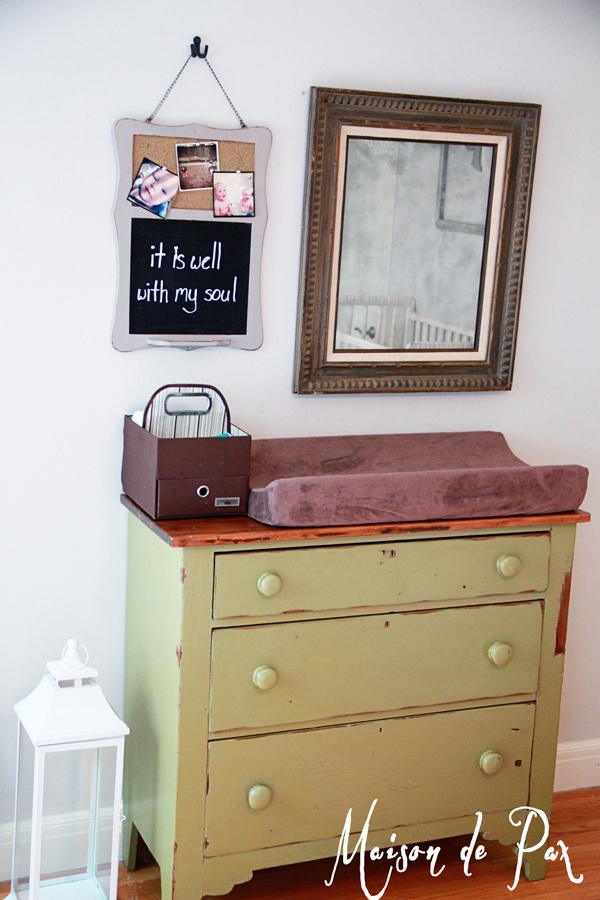 an adorable farmhouse dresser makes a bold statement in a natural green