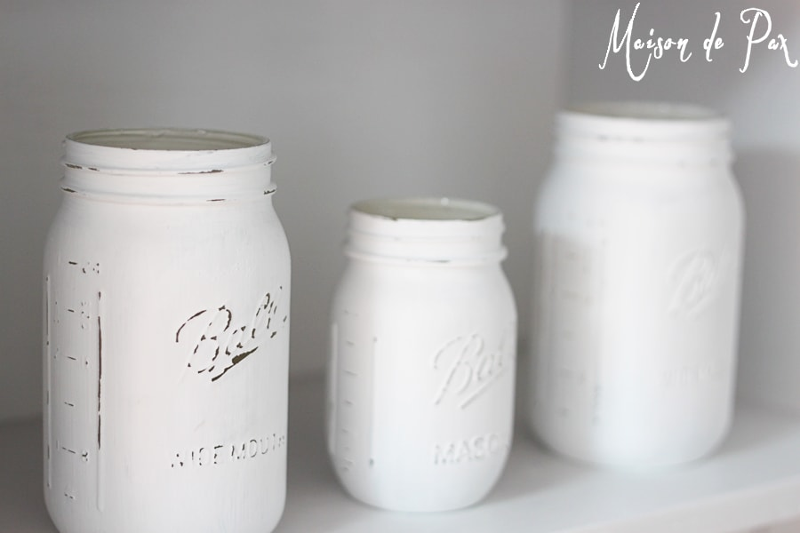 White painted mason jars on a white shelf... lovely!