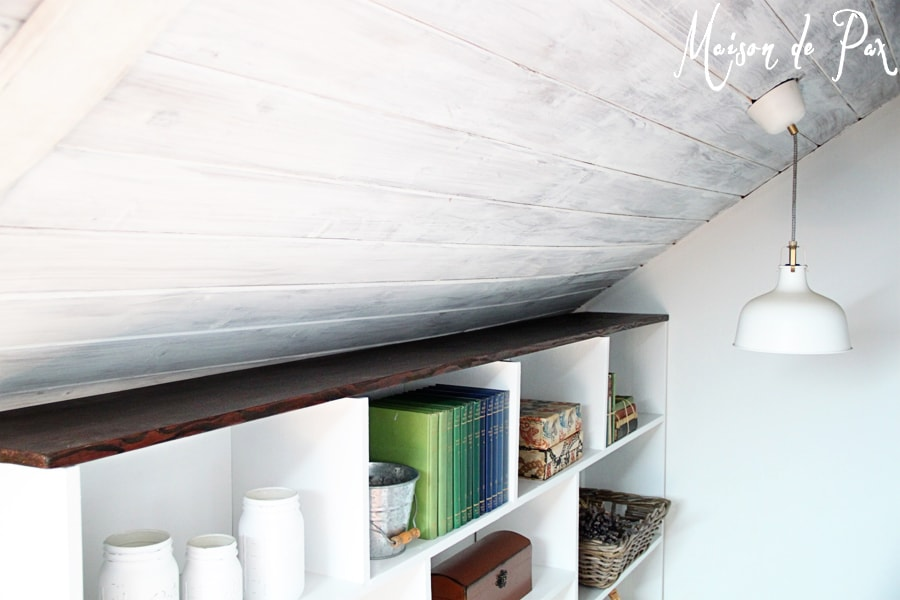 A DIY stairwell bookcase provides a creative and beautiful way to open the space and bring light into the stairwell.  Click through to see details and instructions!