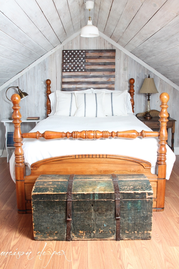Small attic bedroom with wooden American Flag- Maison de Pax