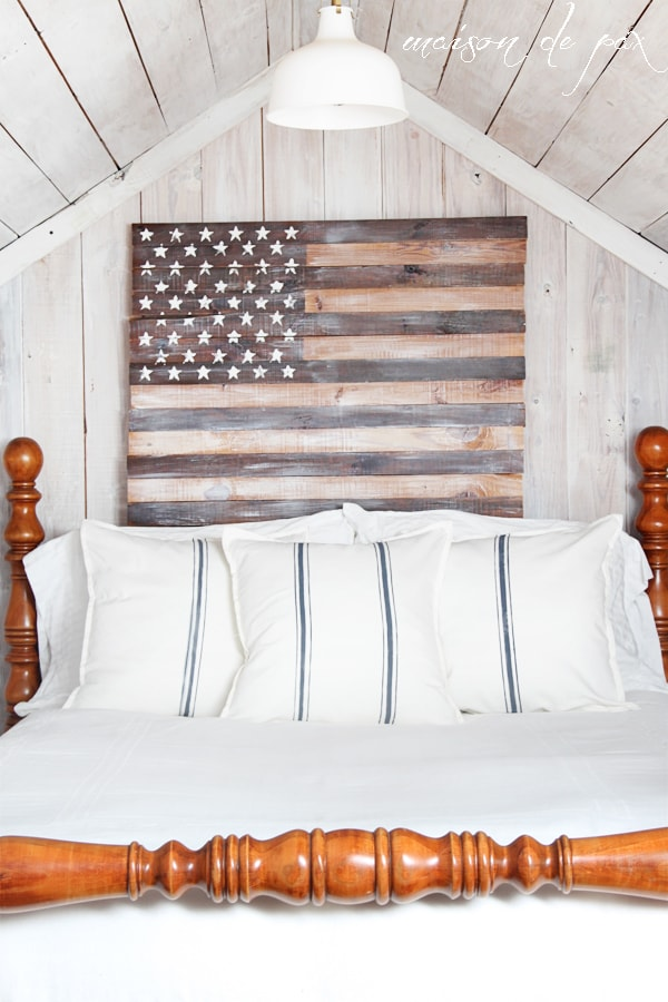 Close up of white bedding and planked American Flag- Maison de Pax