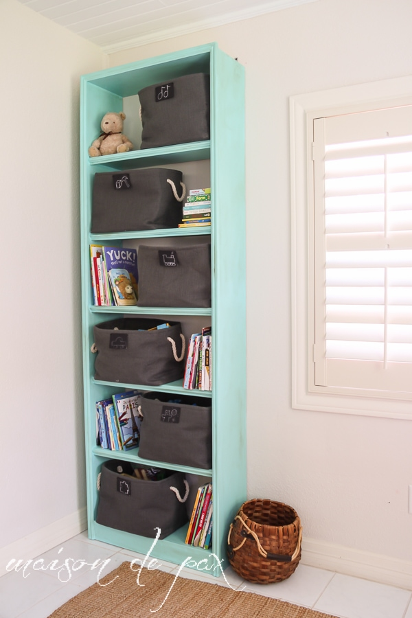 "Fabulous ""vintage aqua"" bookcase makeover for adorable and functional playroom storage at maisondepax.com #makeover #furniture #paint #diy #tutorial #chalkpaint"