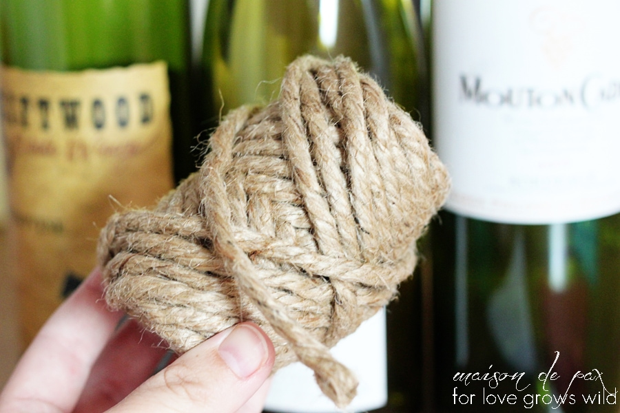 rustic, nautical, versatile wine bottles wrapped in jute twine at maisondepax.com... use them as centerpiece, bookends, vases, or accents!