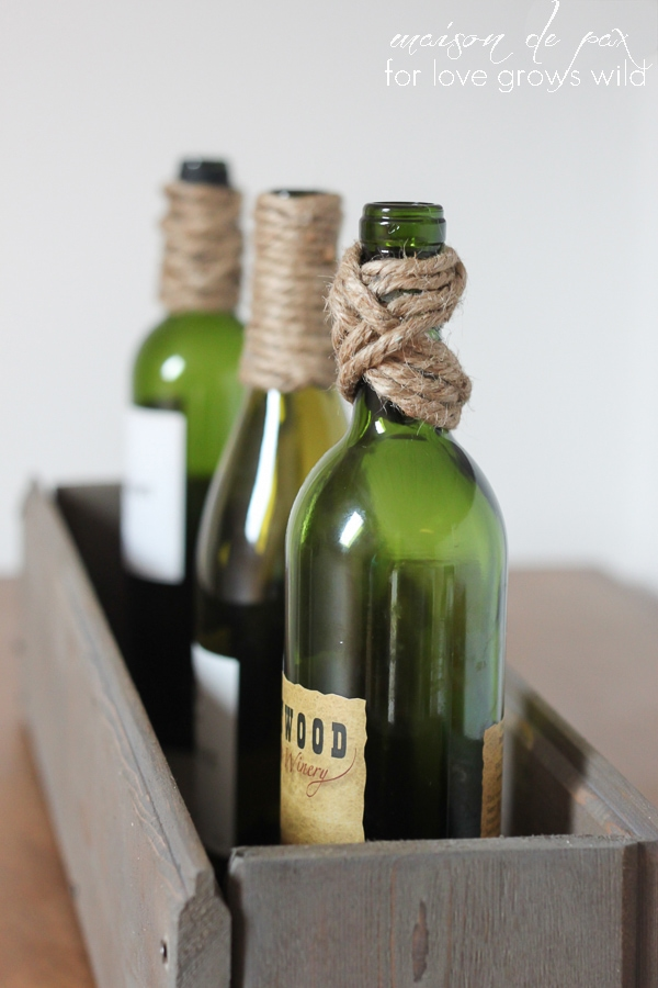 These Twine-Wrapped Bottles are inexpensive to make and the perfect easy DIY decor project! Use them as a centerpiece, vases, bookends, and more!   LoveGrowsWild.com