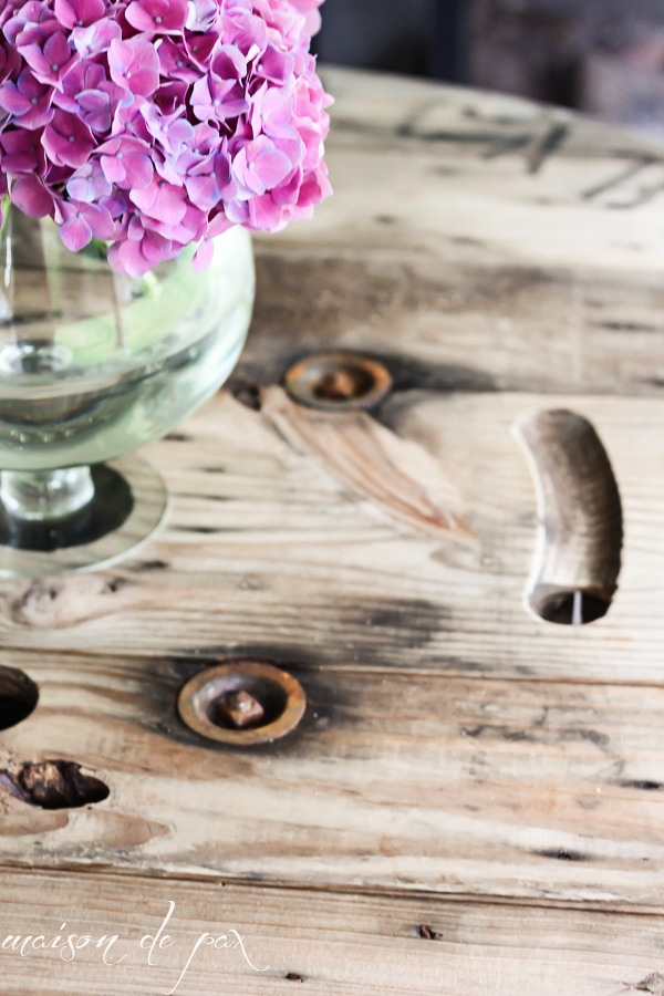 DIY Industrial Spool Table with a vase of hydrangeas- Maison de Pax