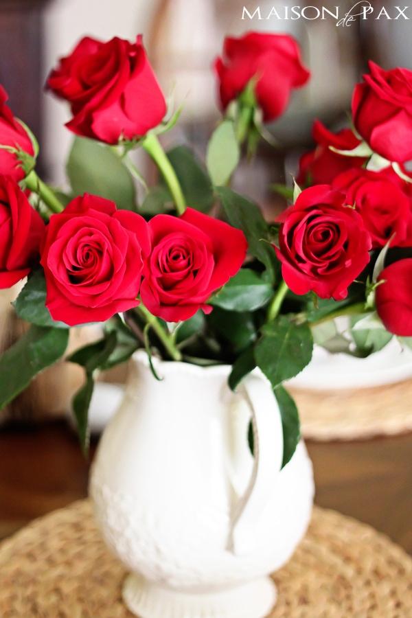 A vase of red roses- Maison de Pax