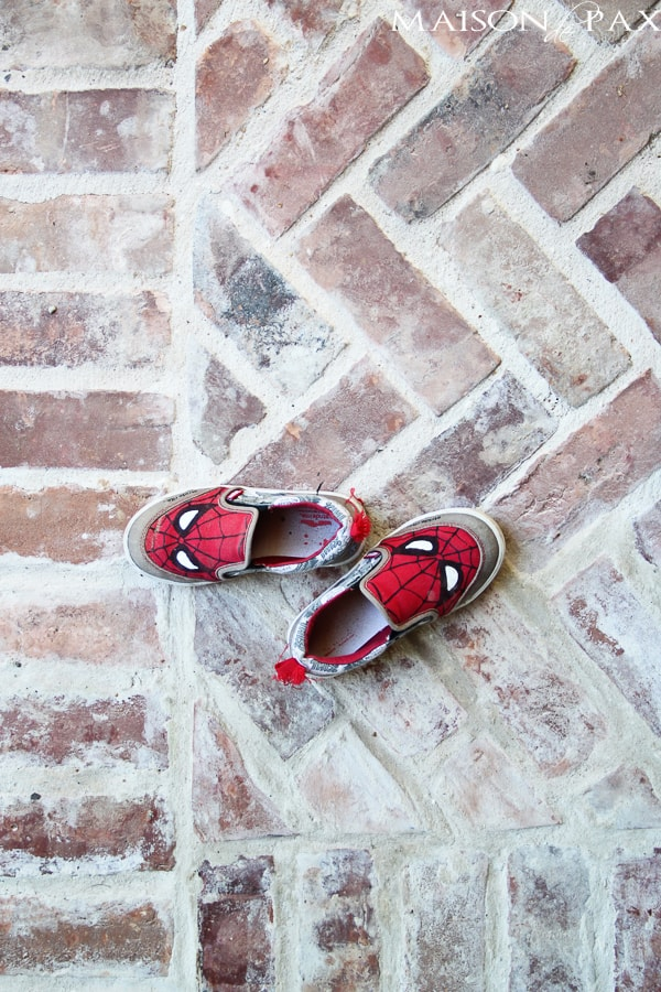 Stamped brick patio with kids shoes- Maison de Pax