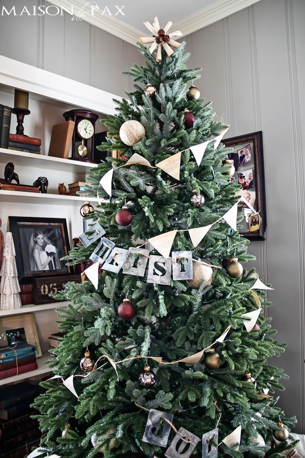 Love this simple Christmas tree decorating idea! Book page bunting and ornaments with stenciled words... Simple and beautiful! via maisondepax.com