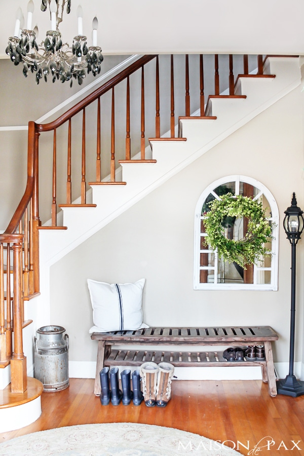 Bench and chandelier in entry with stairwell | maisondepax.com