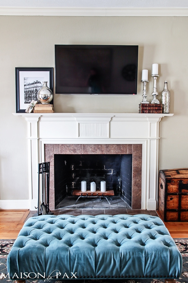 tufted ottoman and mercury glass on mantel | maisondepax.com
