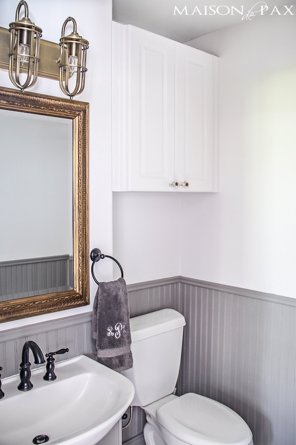 Small powder bathroom in gray and white- Maison de Pax