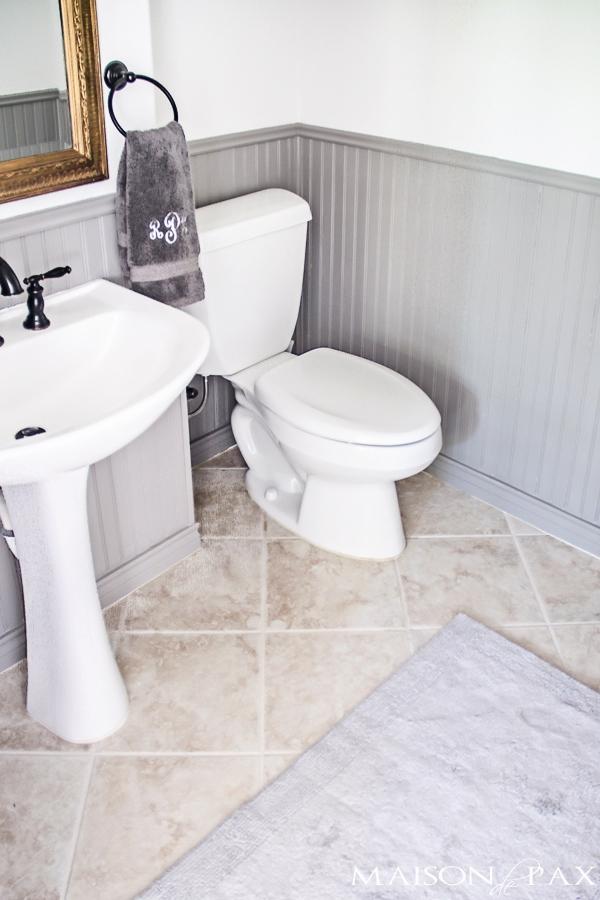 Small powder bathroom in gray and white- Maison de Pax