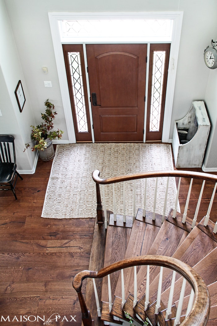 gorgeous stairwell and functional entryway with an antique wood firebox used as a mini mudroom | maisondepax.com