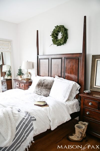 lovely white master bedroom with touches of greenery, warm throws, and texture for winter | maisondepax.com