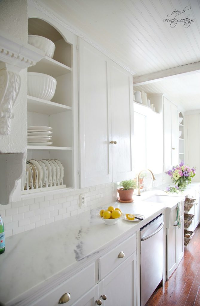 all white kitchen with beautiful marble countertops