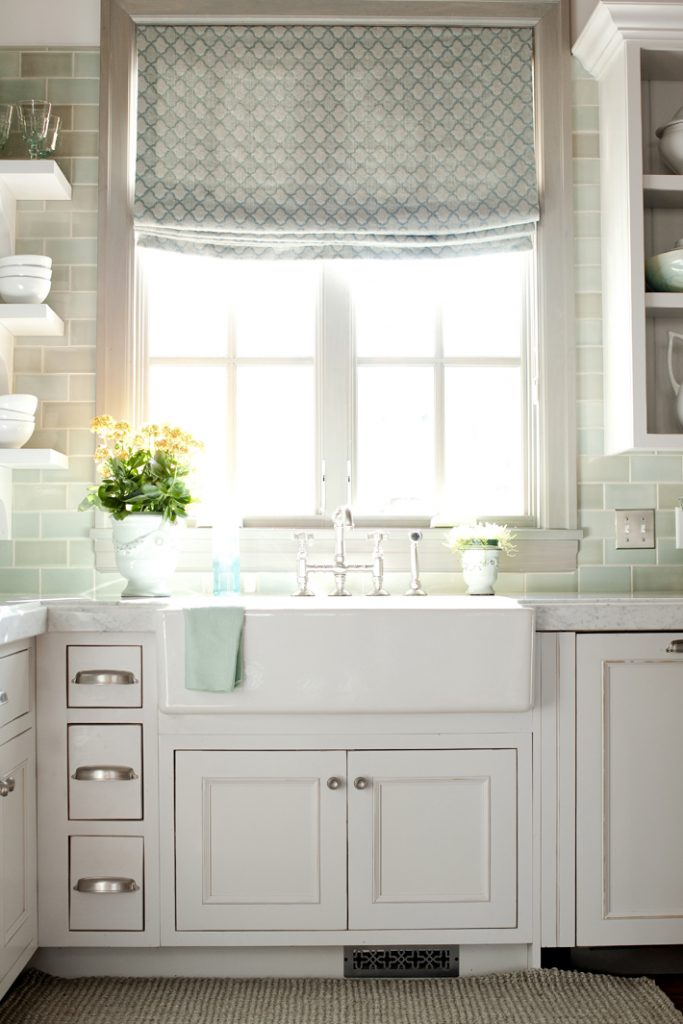 white kitchen with green glass subway backsplash