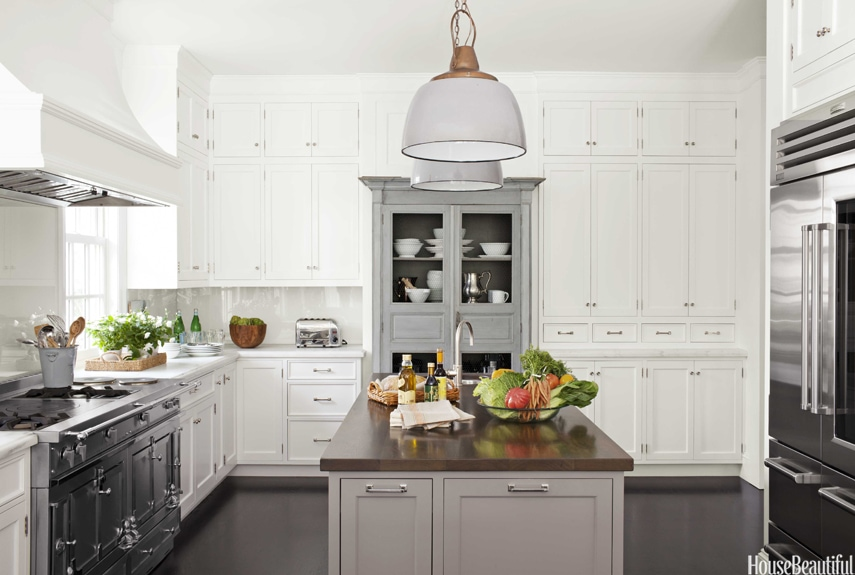 white kitchen with gray island and furniture style storage