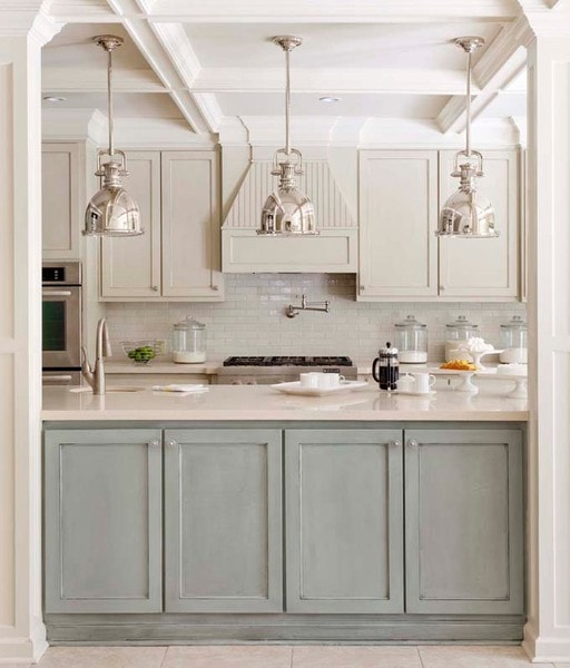 industrial chrome or polished nickel lighting in a gray and blue kitchen