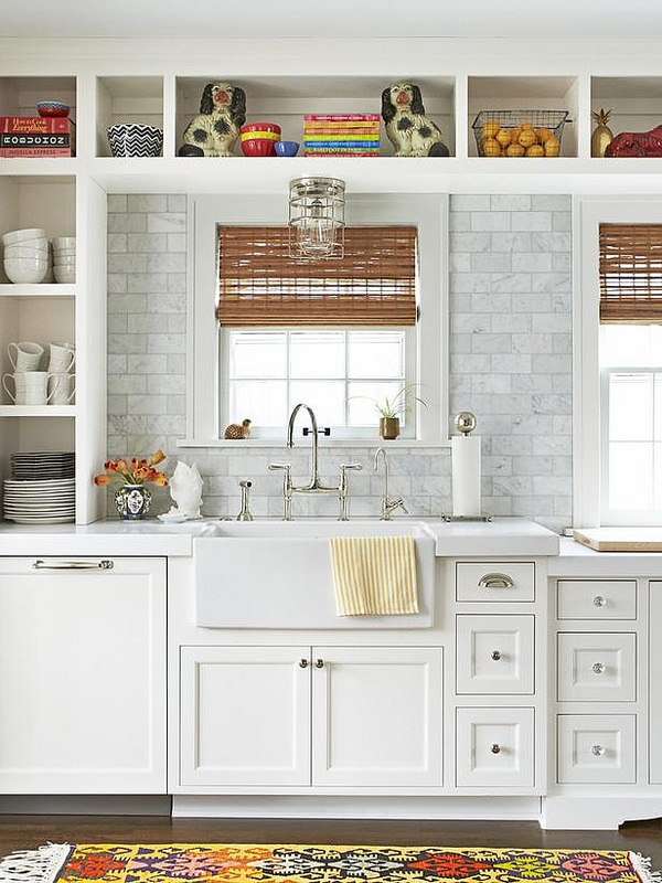 white kitchen with open shelves, farmhouse sink marble countertops and marble subway tile backsplash