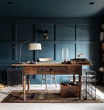 stunning dark teal office with rich wood accents