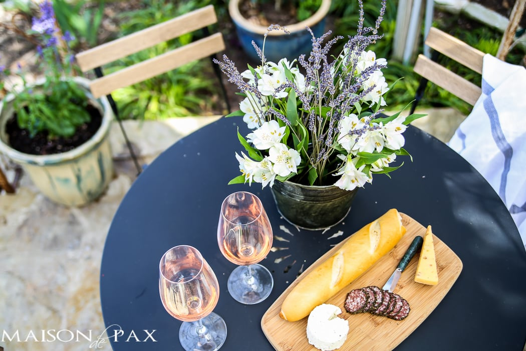 al fresco bistro dining with rose, french bread, and cheese | Maison de Pax