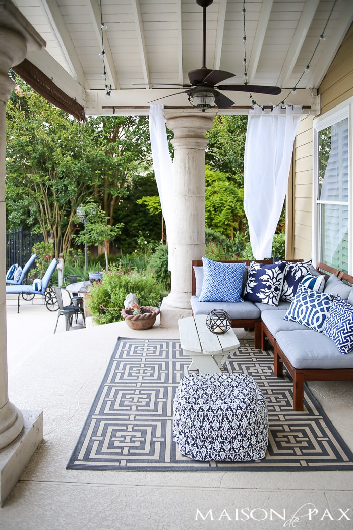 What a lovely back porch! Beautiful summer home tour with lots of whites, raw wood tones, and simple summer decorating ideas