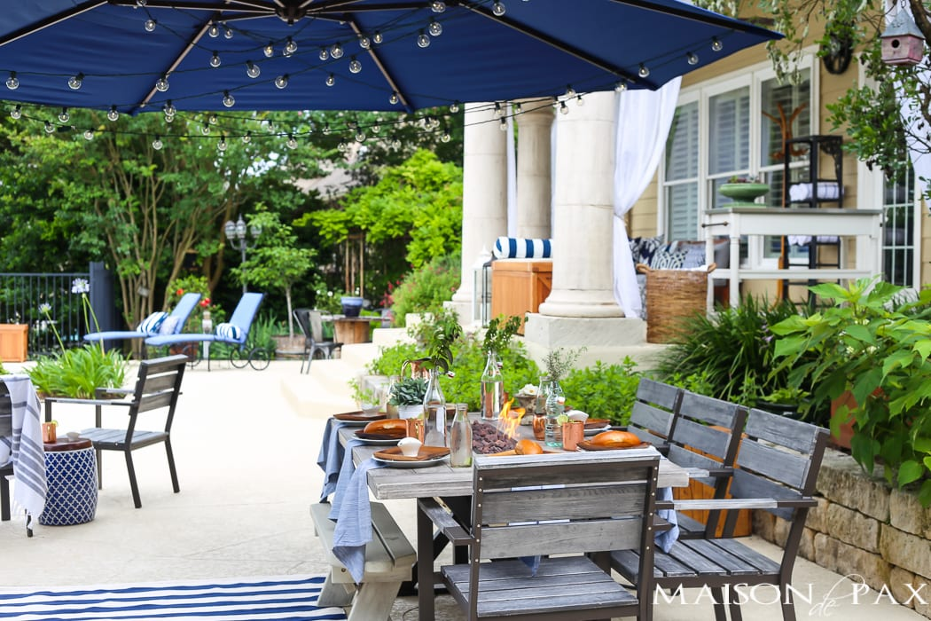 Outdoor dining space with grill and table setting - Maison de Pax