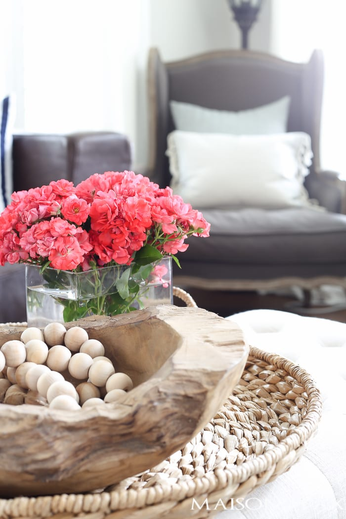 love the wooden beads and bowl in the basket tray! how to decorate your home for summer in 10 minutes or less | quick summer decorating ideas