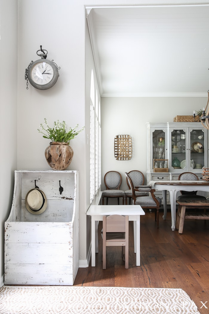 Love the rustic white boot box! Beautiful summer home tour with lots of whites, raw wood tones, and simple summer decorating ideas