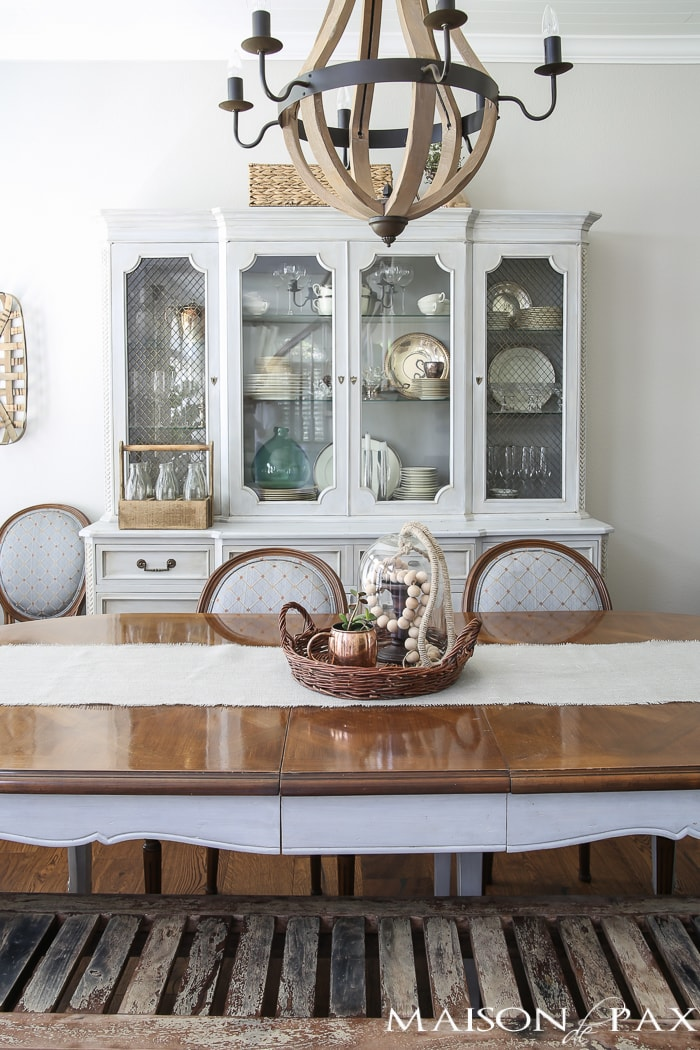 Love the wine barrel chandelier and the lovely grey French farmhouse dining room! Beautiful summer home tour with lots of whites, raw wood tones, and simple summer decorating ideas