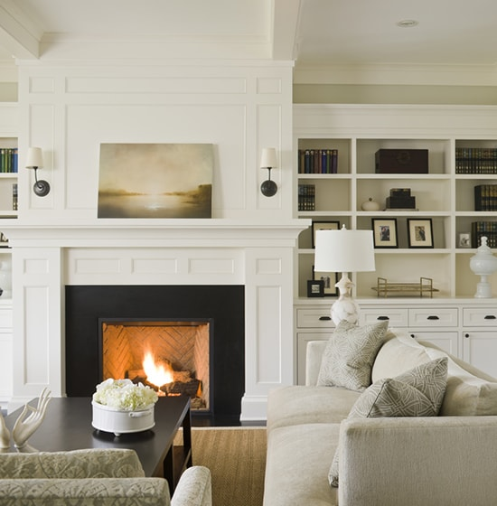 fireplace with white mantel and molding above- Maison de Pax