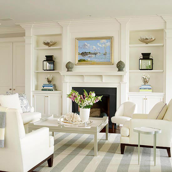 fireplace with white mantel, moldings, and built in bookcases- Maison de Pax