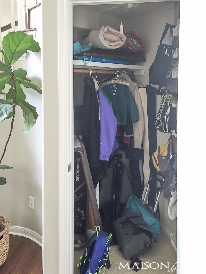 "This is the ""before""... you won't believe the after! This closet is turned into a mini mudroom with some clever storage"