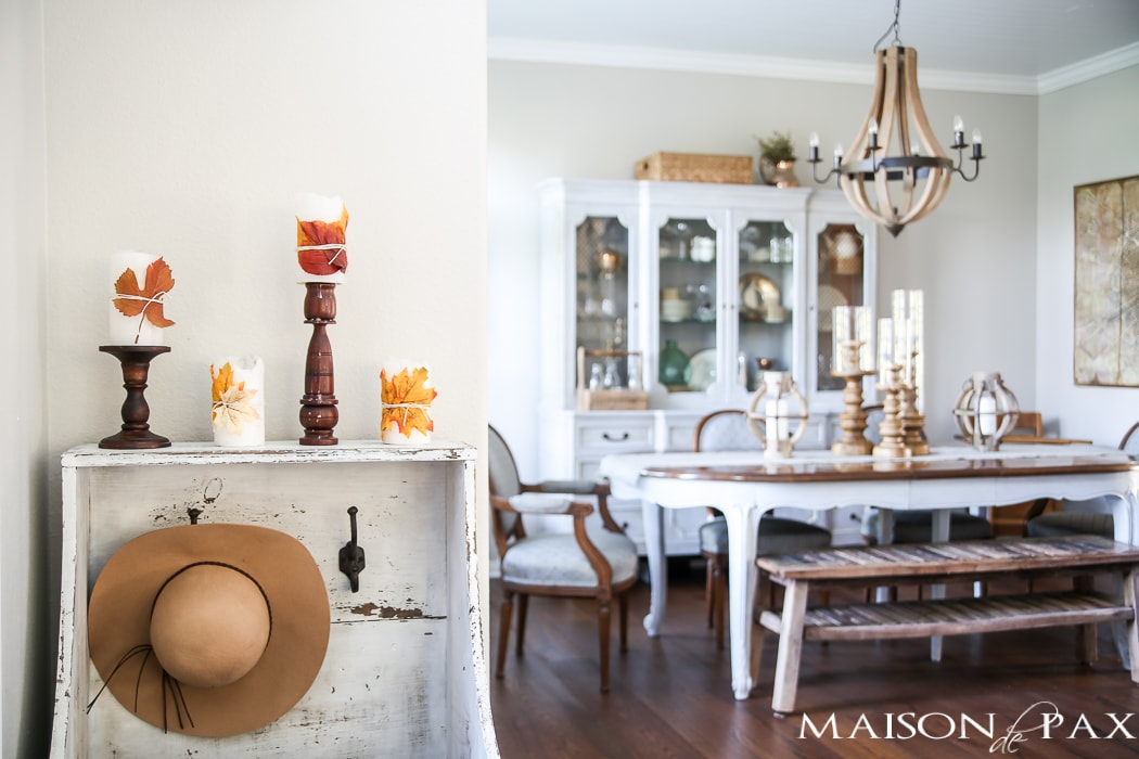 leaf wrapped candles give a slight nod to fall in this neutral home- Maison de Pax