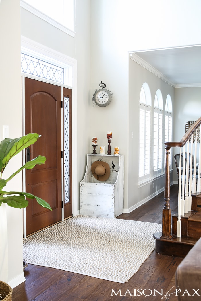 Beautiful light-filled foyer with a touch of fall decor