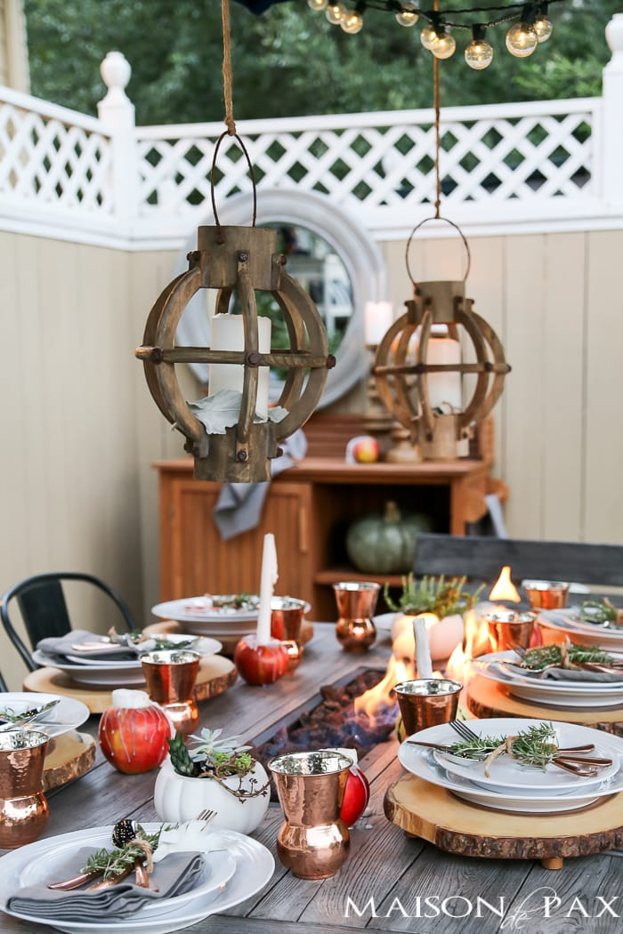 Create a rustic outdoor wedding table with unique candles, string lights, and greenery - Maison de Pax