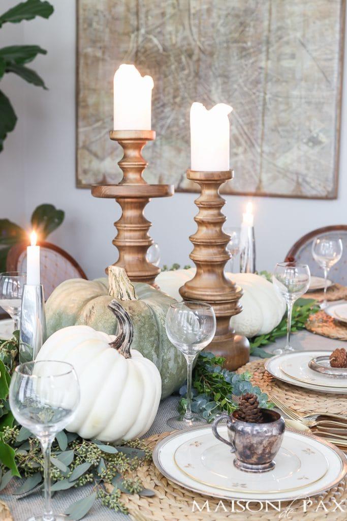 White pumpkins and wooden candlesticks- Maison de Pax