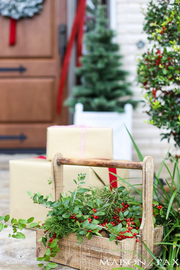 Greenery and Red Holiday Front Porch: What a beautiful, classic look! Get Christmas front porch decorating ideas here!