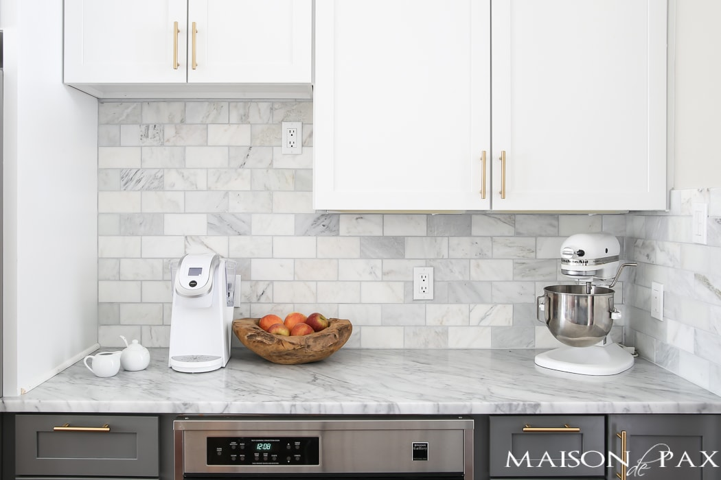 marble counters and backsplash with white appliances- Maison de Pax