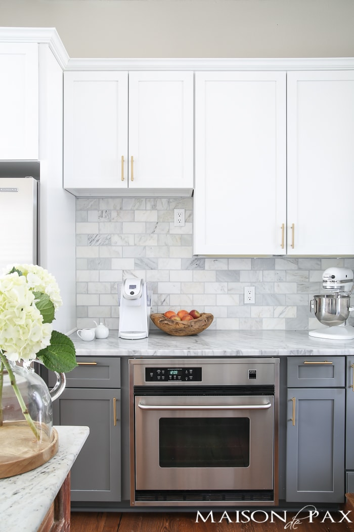 protecting marble from stains: Should I use marble in the kitchen?  It's one of the most common questions for today's kitchen design!  Read all about the pros and cons of marble countertops as well as what it is like living with honed marble countertops in a household with kids. #carraramarble #marblebacksplash #marblecountertops #marblecounters #marblekitchen