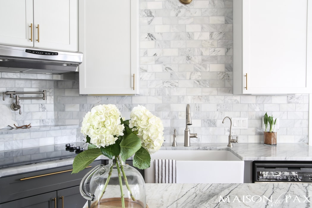 White kitchen with marble countertop- Maison de Pax