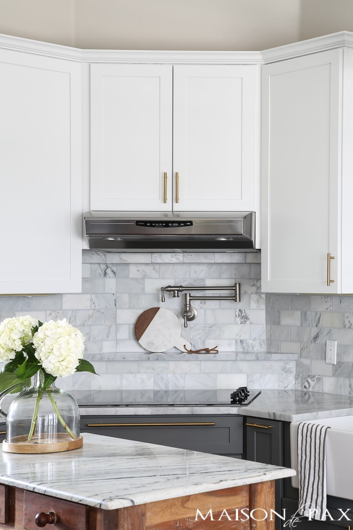 brushed nickel pot filler with marble subway tile backsplash | Maison de Pax